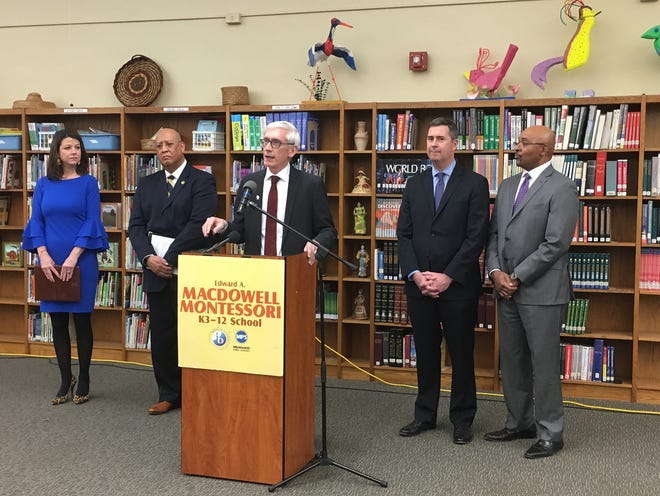 Gov.-elect Tony Evers (center) announces key cabinet official appointments at MacDowell Montessori School. From left to right are: Sara Meaney, Department of Tourism; Kevin A. Carr, Department of Corrections; Evers; Joel Brennan, Department of Administration; and Preston Cole, Department of Natural Resources.