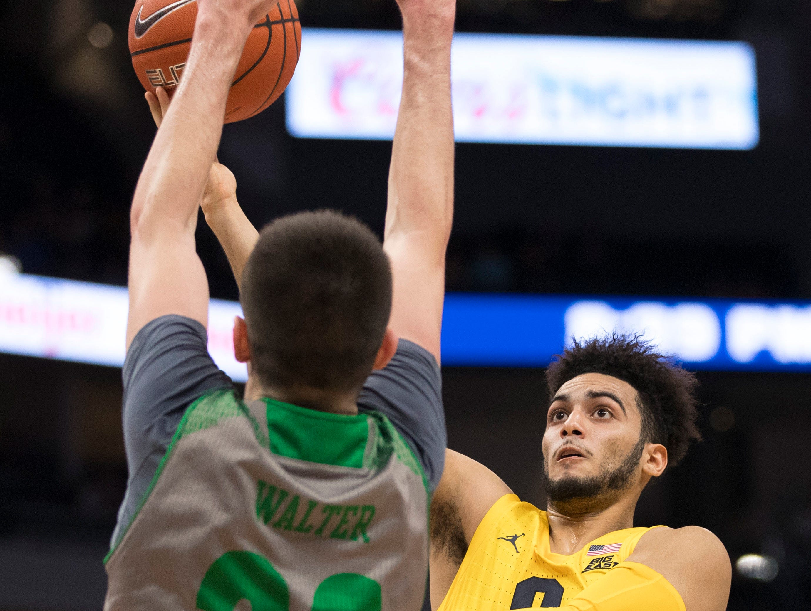 Markus Howard of Marquette gets in the lane for a shot against North Dakota's Kienan Walter on Tuesday night.