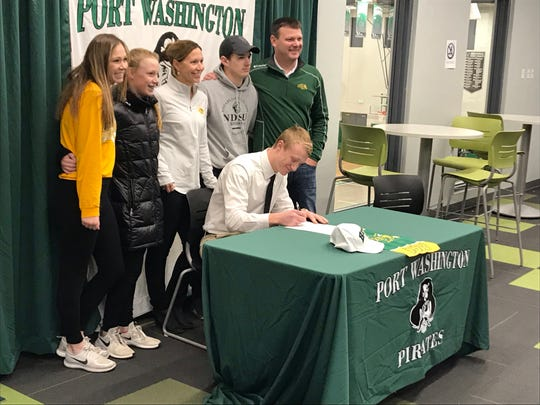 Jacob Lippe signs his National Letter of Intent to play football at North Dakota State University on Wednesday.