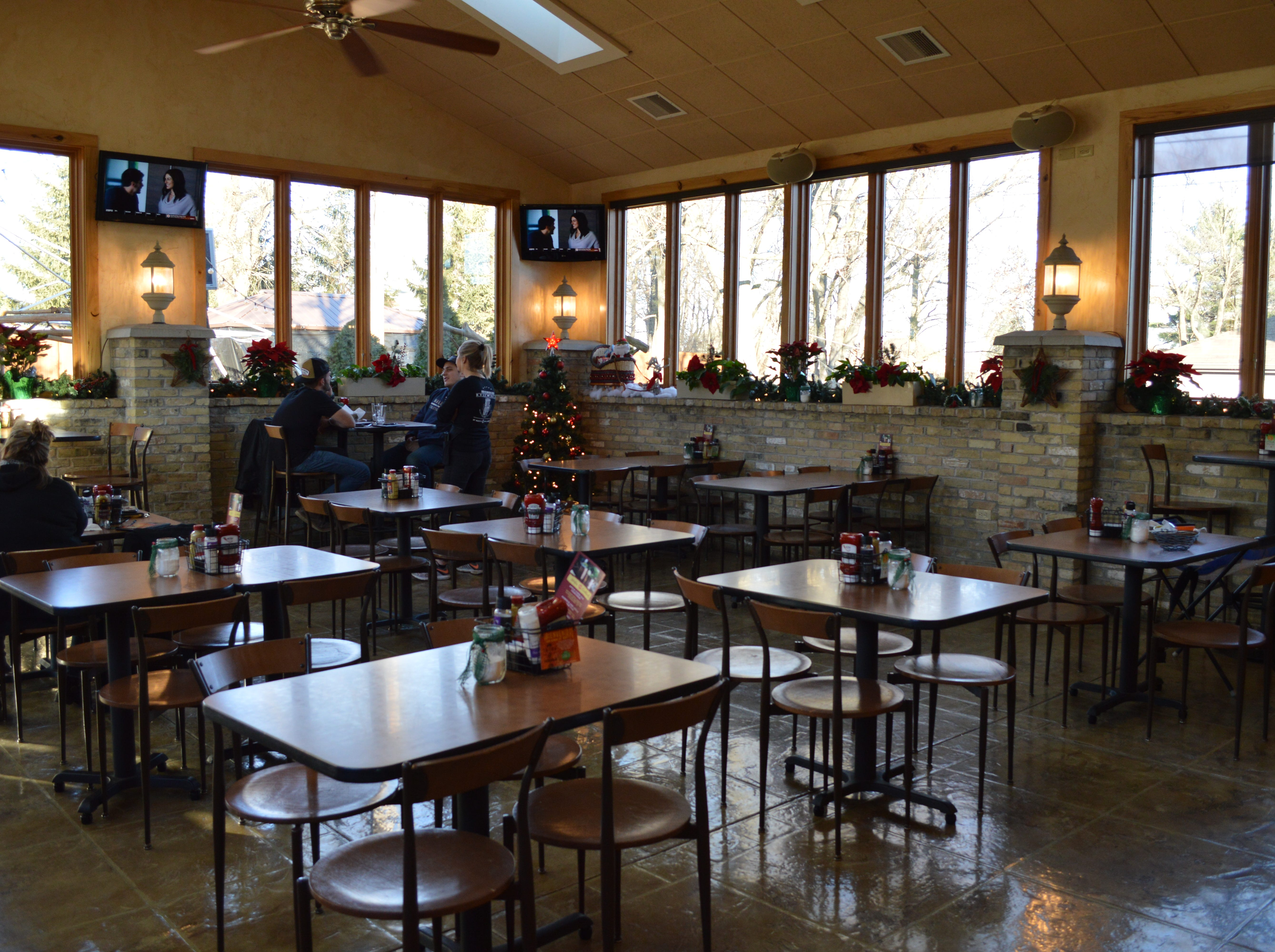 An open-air Cream City Brick beer garden was transformed into this four-seasons room in 2010.