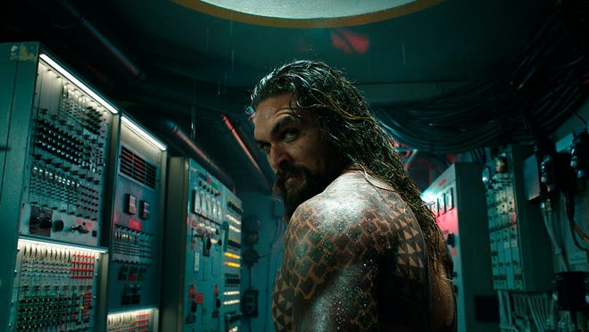 "Jason Momoa flexes his, um, power in ""Aquaman."" (Warner Bros. Pictures via AP) ORG XMIT: NYET202"