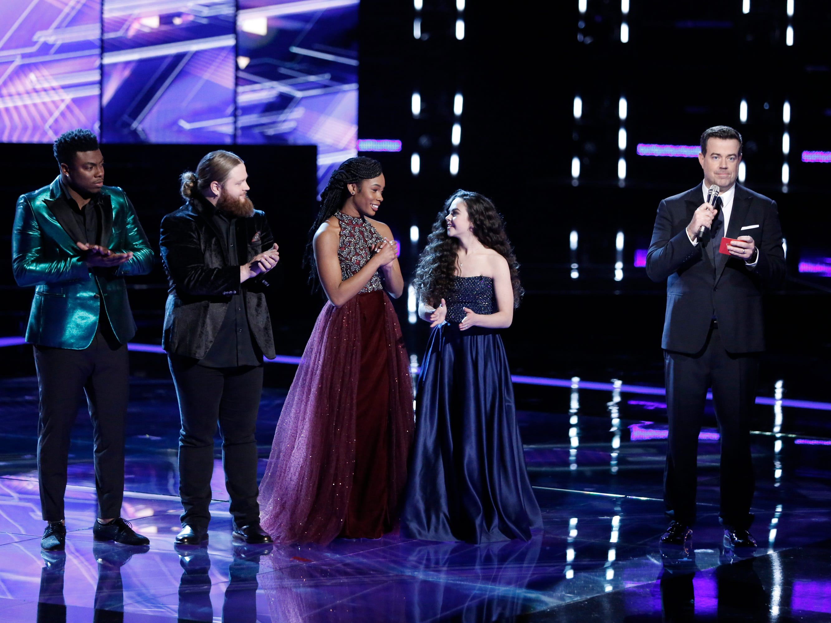 """Finalists (left to right) Kirk Jay, Chris Kroeze, Kennedy Holmes and Chevel Shepherd wait for Carson Daly to reveal the winner of """"The Voice"""" season 15 Dec. 18."""