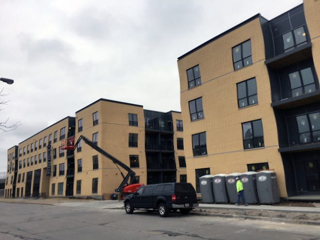 River House apartments, shown finishing construction in 2017, has been sold to a Seattle-area firm for $58 million.