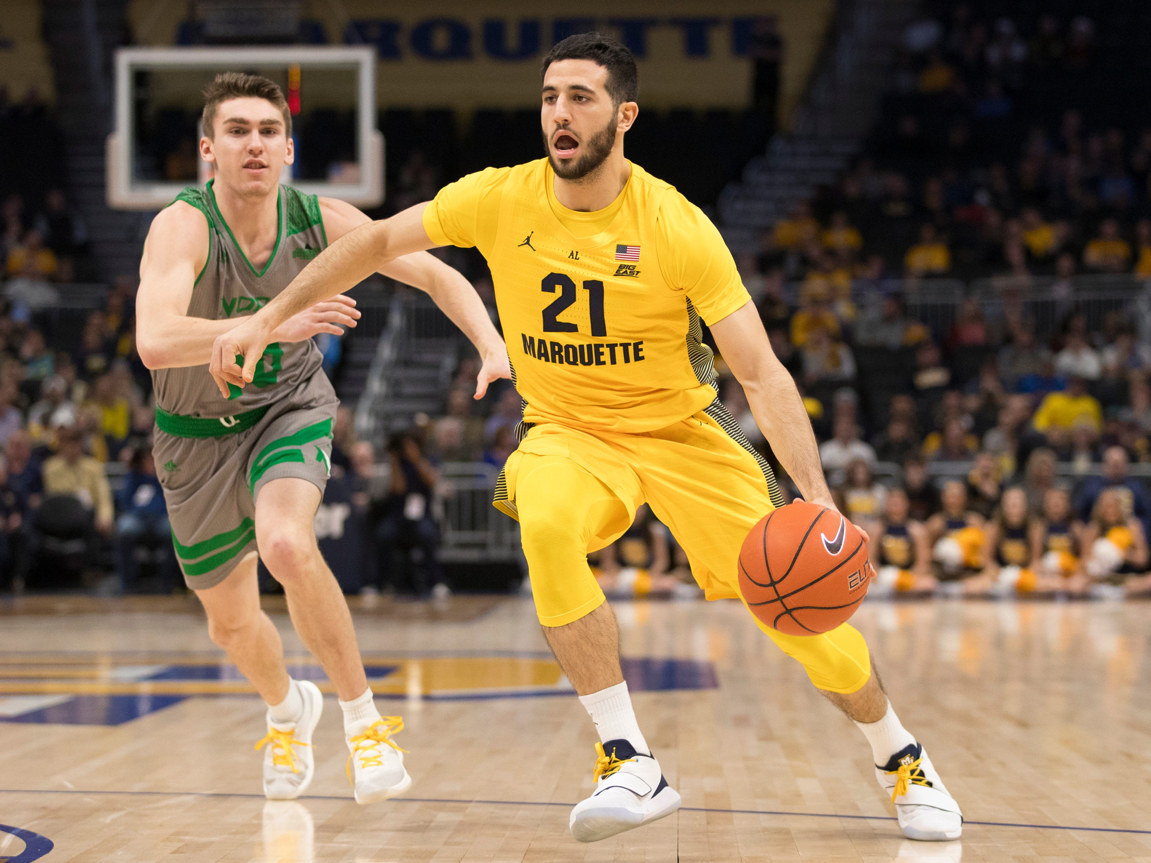 Marquette guard Joseph Chartouny  drives to the basket during the first half against the Fighting Hawks on Tuesday night.