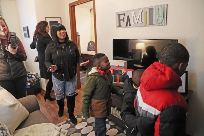 Sade and her children visit their Habitat for Humanity home they are moving into. Sade and her three children, Demarion, 9, Robert, 7, and Samir, 4,   were expecting it to be empty. But through retired NFL star Warrick Dunn's charity and other Habitat partners, the home was fully furnished.