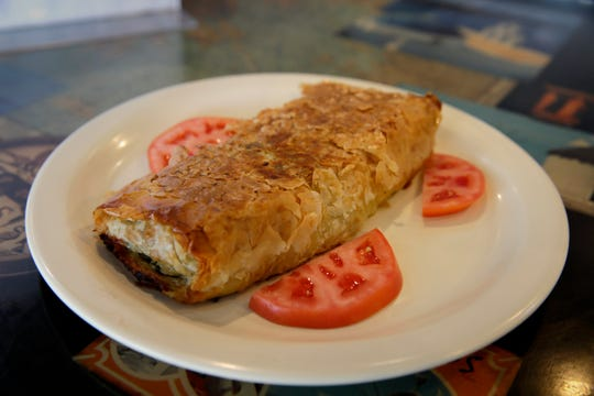 Spanokopita (phyllo dough stuffed with spinach, feta and herbs) is one of the most popular menu items at Mykonos Gyro & Cafe, 1014 N. Van Buren St.