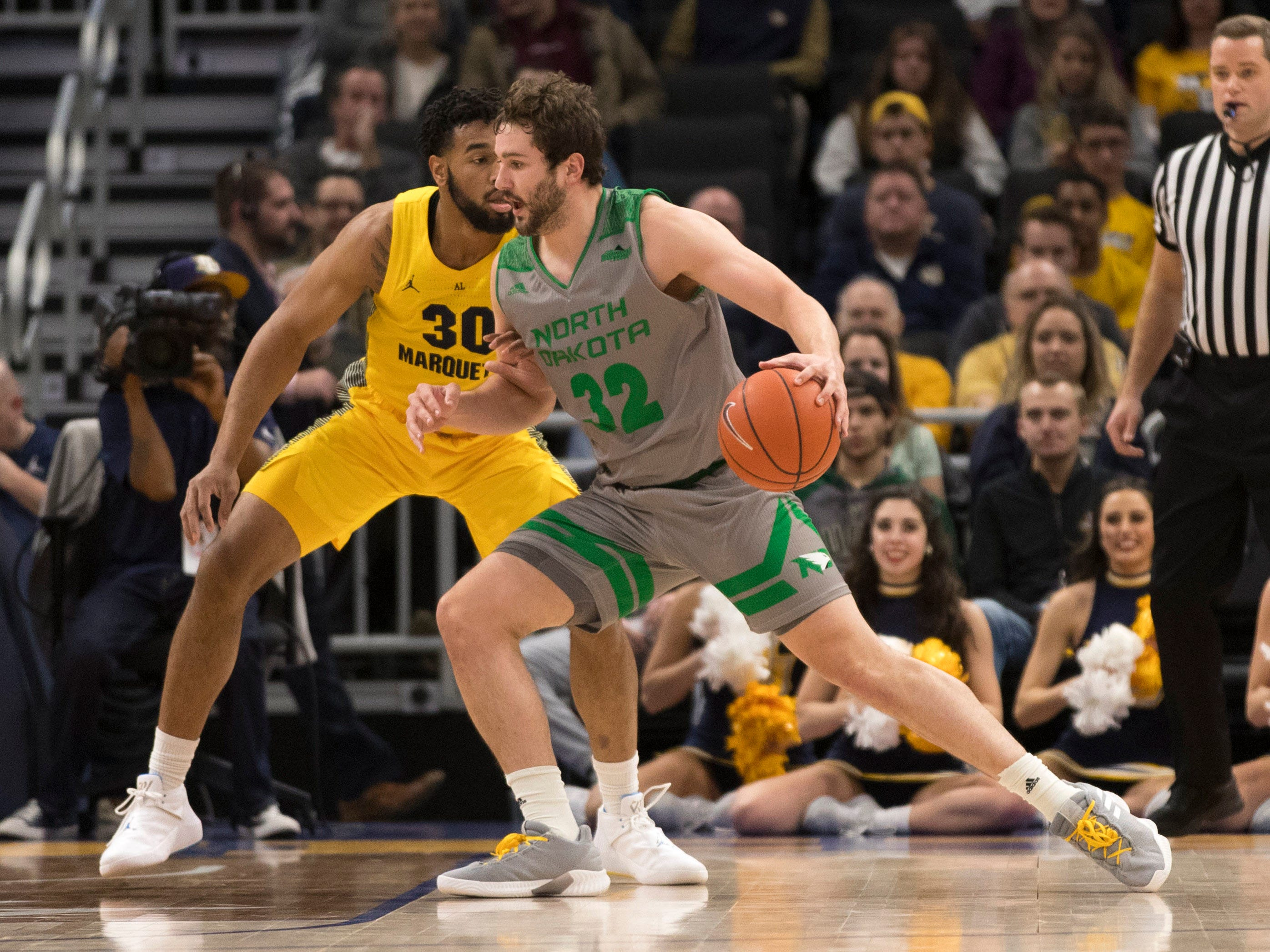 North Dakota forward Conner Avants tries to get around Marquette forward Ed Morrow on the block during the first half Monday night at Fiserv Forum.
