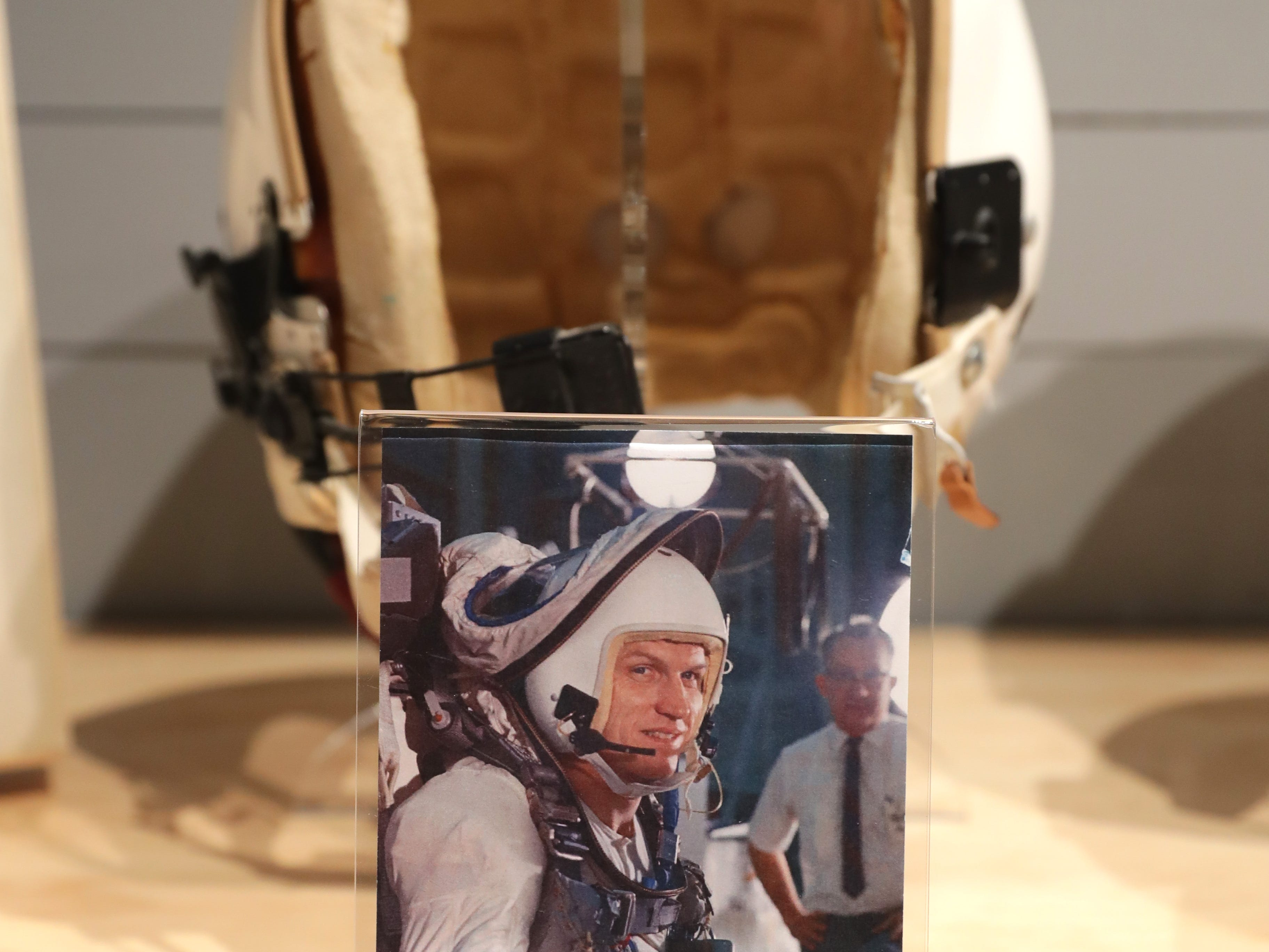 The protective helmet that astronaut Frank Borman (shown in foreground) wore during training for the Gemini 7 mission is one of the artifacts in a new exhibit at the EAA AirVenture Museum in Oshkosh. The exhibit is made up of part of a trove of personal memorabilia given to the museum by Borman, who commanded the Apollo 8 mission 50 years ago this month.