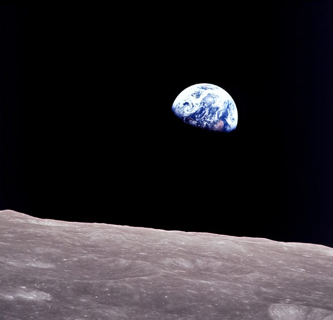 """Apollo8, the first manned mission to the moon, entered lunar orbit on Christmas Eve, Dec. 24, 1968. That evening, the astronauts-Commander Frank Borman, Command Module Pilot Jim Lovell, and Lunar Module Pilot William Anders-held a live broadcast from lunar orbit, in which they showed pictures of the Earth and moon as seen from their spacecraft. Said Lovell, """"The vast loneliness is awe-inspiring and it makes you realize just what you have back there on Earth."""" Image Credit:NASA"""