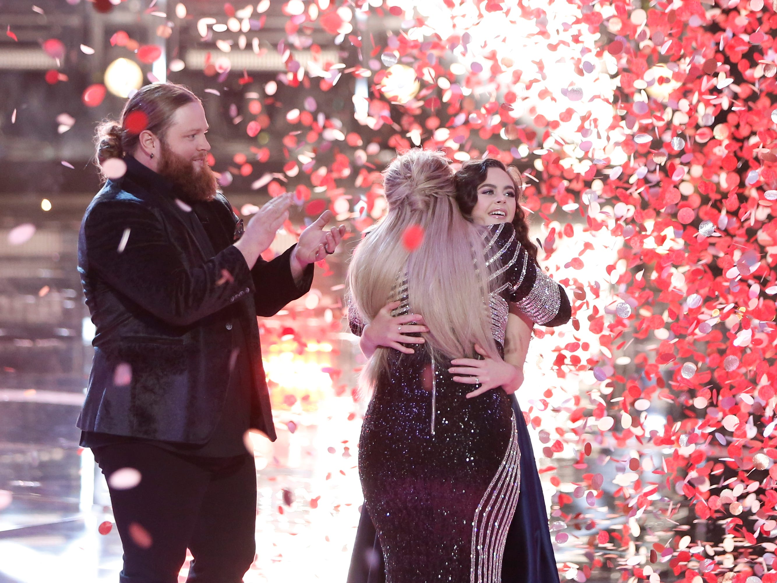 """Country singer Chris Kroeze from Barron applauds for Chevel Shepherd, who won """"The Voice"""" season 15 Tuesday, and her coach Kelly Clarkson. Kroeze came in second place."""