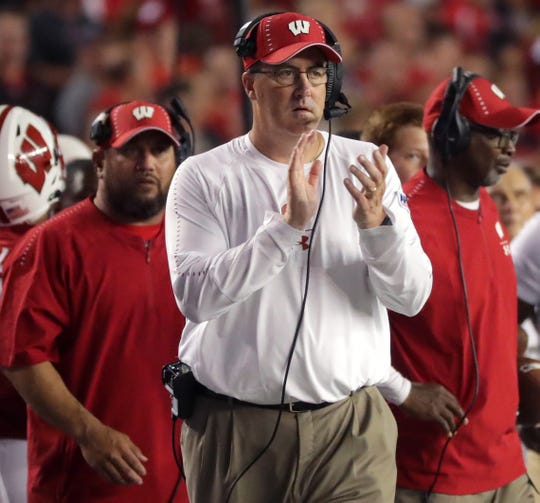 Wisconsin restructured football coach Paul Chryst's contract, boosting his total compensation to $4.15 million per year.