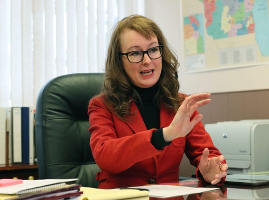Stephanie Bloomingdale, Wisconsin AFL-CIO president, makes a point during an interview in her Milwaukee office.