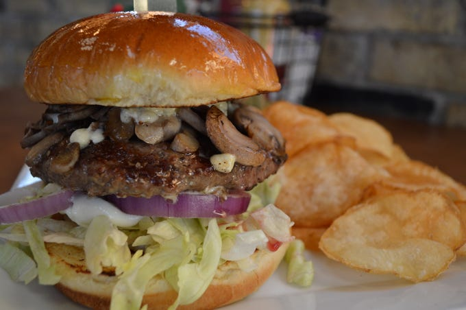 """Matty's """"bleuburger"""" has blue cheese, mushrooms, mayo, romaine and onion on a brioche bun. It comes with a side for $13."""