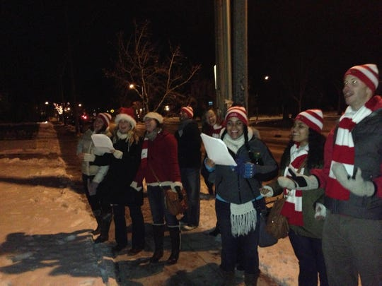 The Tosa Carolers sing along with Christmas music along North Avenue. The group was formed seven years ago and carols one night of the year at homes and businesses.
