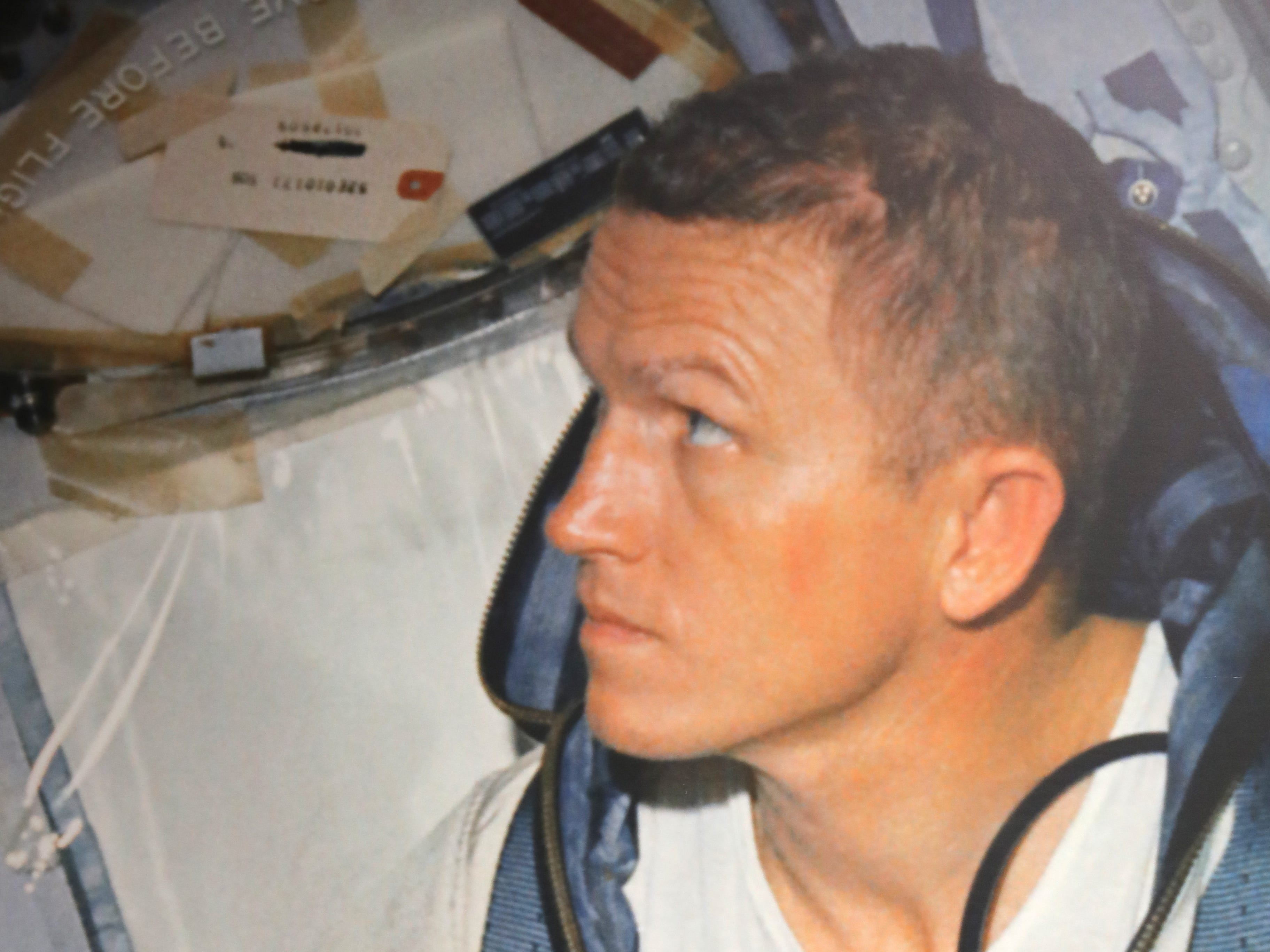 Astronaut Frank Borman is shown in the mid-1960s in this photo on display at the EAA AirVenture Museum in Oshkosh.  The museum recently created a display from personal memorabilia from Borman, who commanded the Apollo 8 mission that in December 1968 was the first manned flight to orbit the moon.