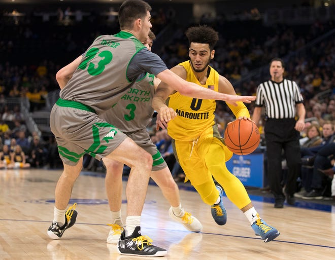 Marquette's Markus Howard drives to the basket against North Dakota on Tuesday night.