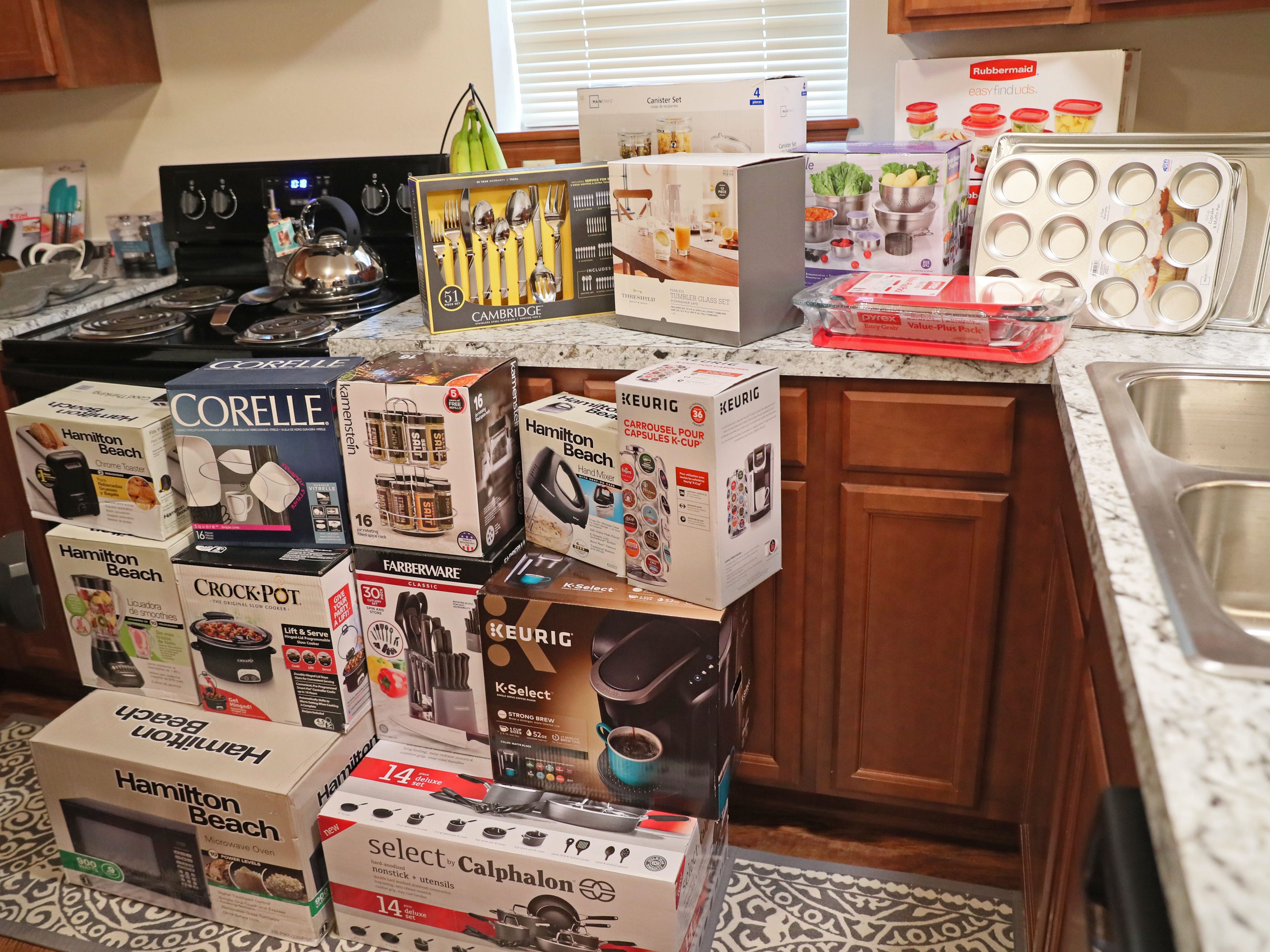 Kitchen items await to be unboxed.