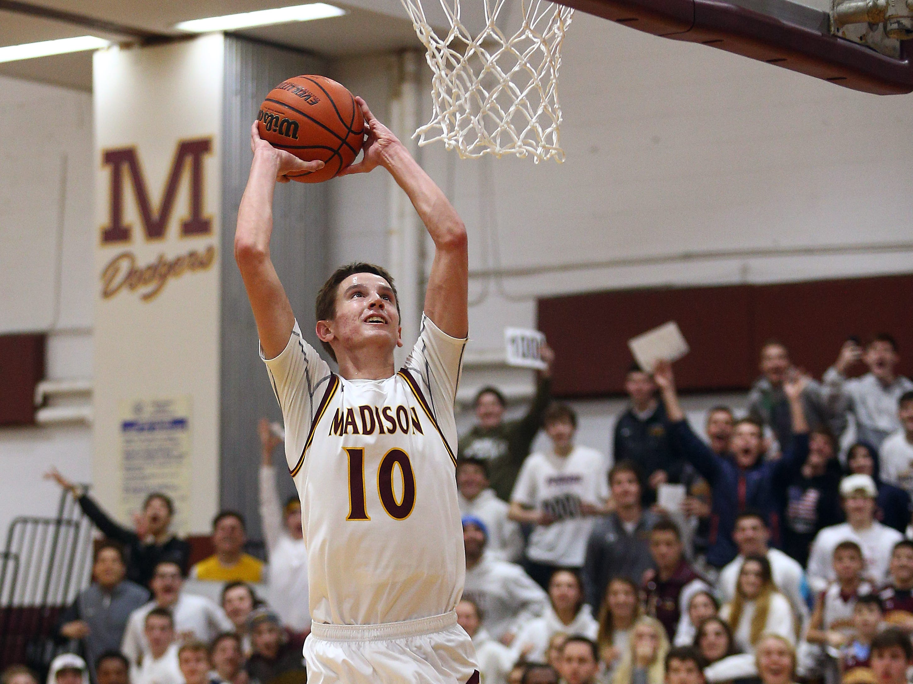 Madison's Andy Christos goes to the hoop for a dunk, his 1000th point during their boys basketball game vs Parsippany. Senior Andy Christos had 22 point surpassing his 1,000th career point. December 18, 2018, Madison, NJ