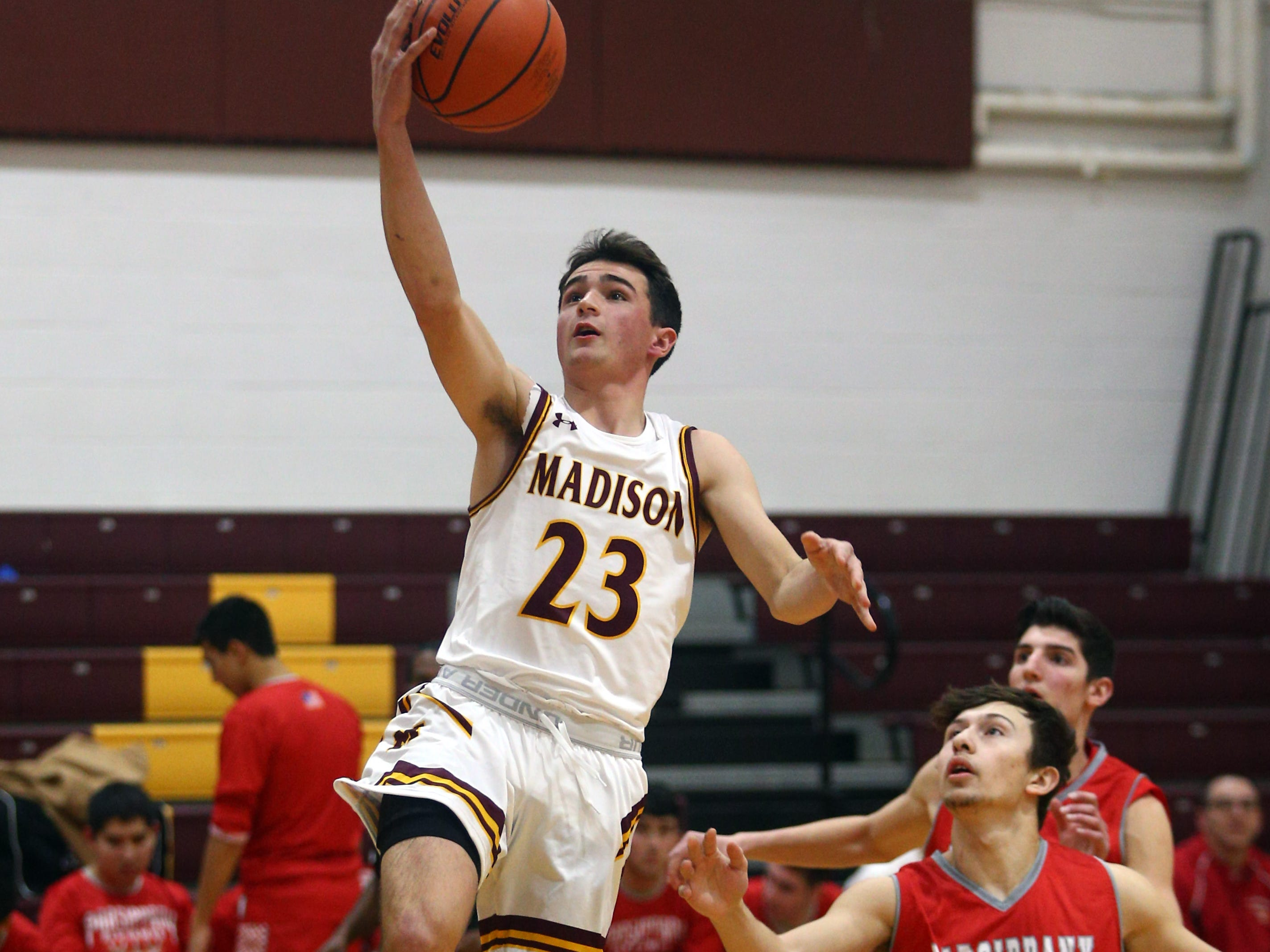 Madison's Ian Magnani goes up for two vs Parsippany during their boys basketball game. Senior Andy Christos had 22 point surpassing his 1,000th career point. December 18, 2018, Madison, NJ