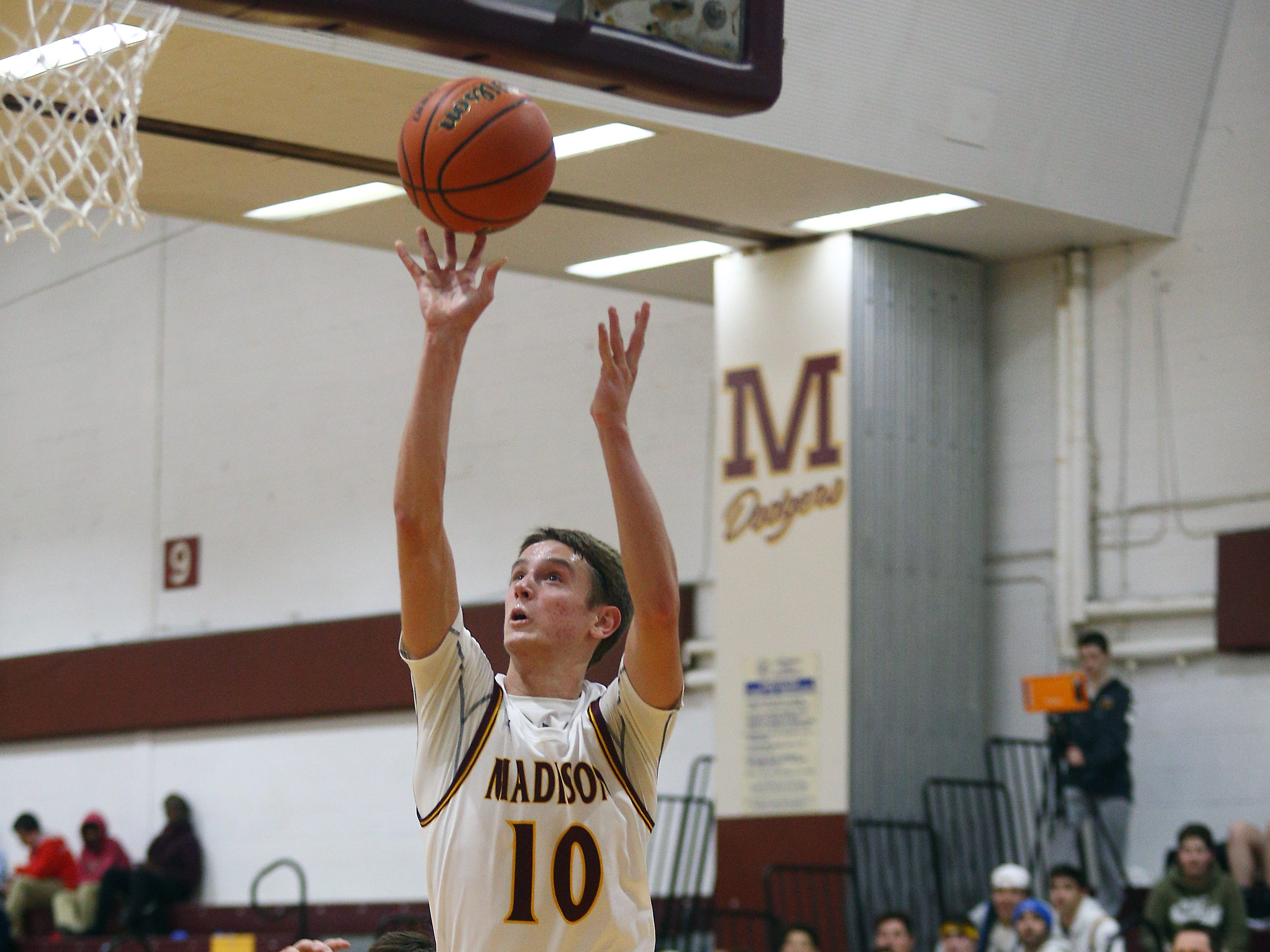 Madison's Andy Christos goes to the hoop vs Parsippany during their boys basketball game. Senior Andy Christos had 22 point surpassing his 1,000th career point. December 18, 2018, Madison, NJ