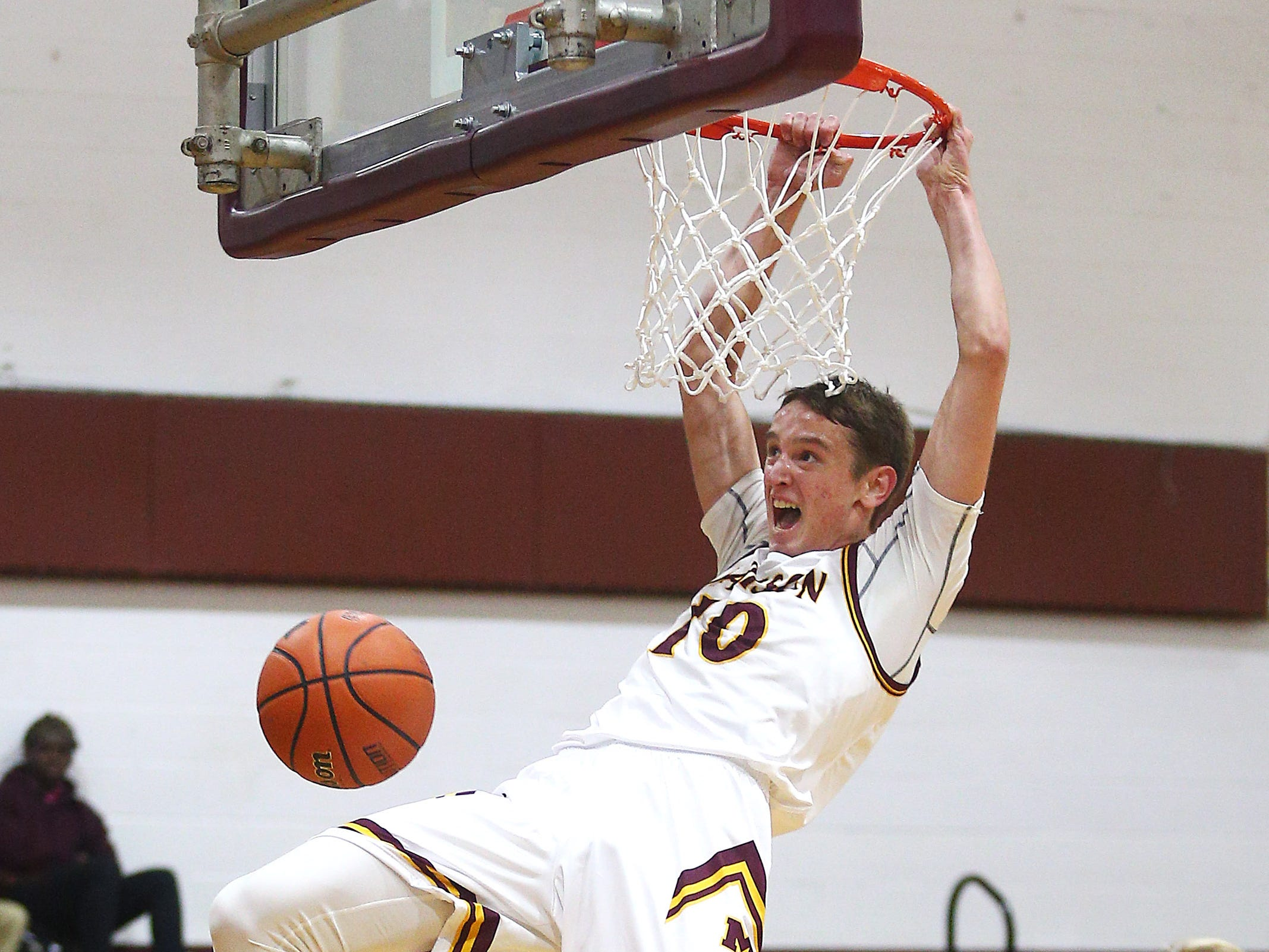 Madison's Andy Christos goes to the hoop for a dunk vs Parsippany during their boys basketball game. Senior Andy Christos had 22 point surpassing his 1,000th career point. December 18, 2018, Madison, NJ