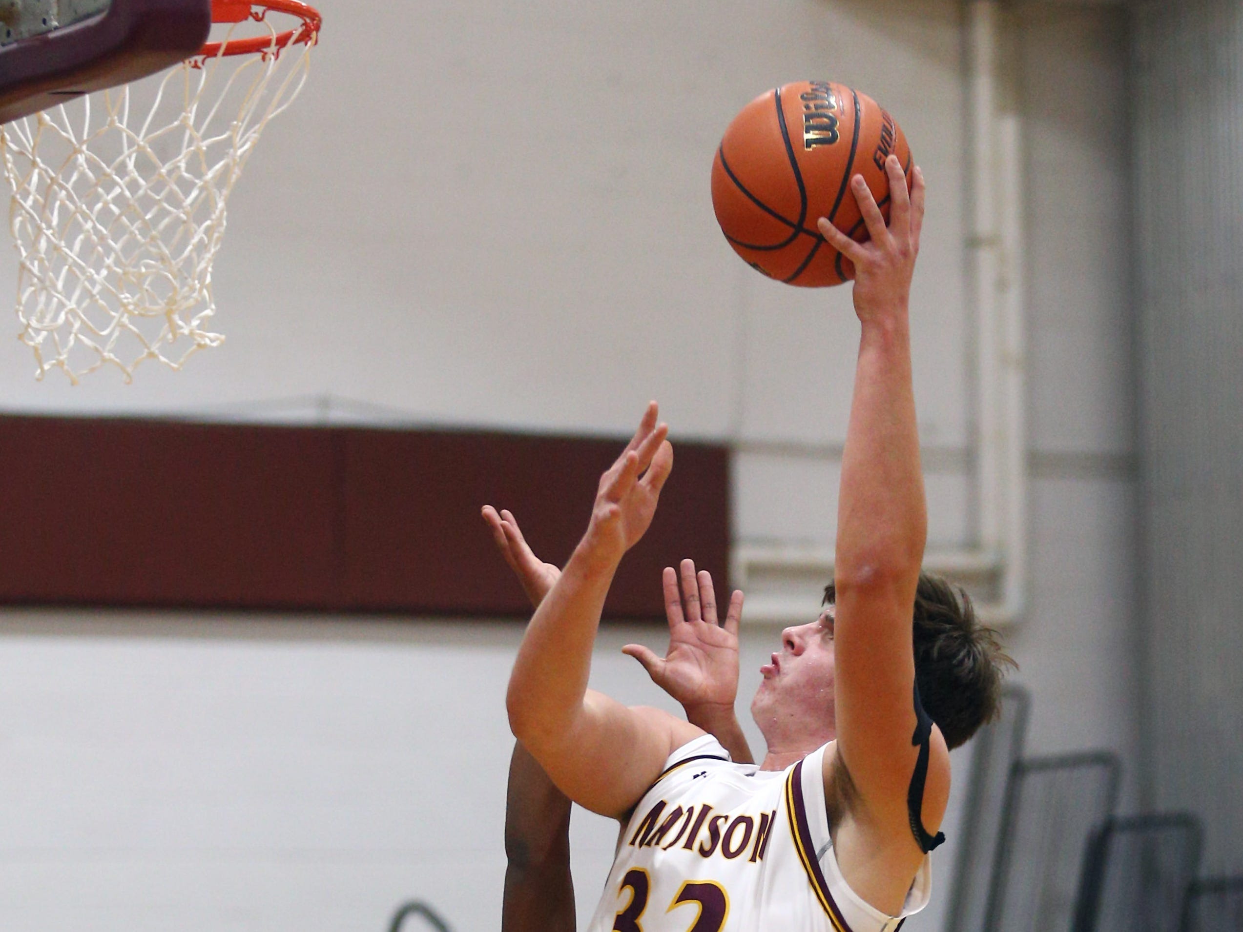 Madison's Paul Saurer goes up for two vs Parsippany during their boys basketball game. Senior Andy Christos had 22 point surpassing his 1,000th career point. December 18, 2018, Madison, NJ