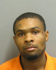 Rasheed Rogers was charged with two counts of assault and a count of shooting into an occupied vehicle or building.