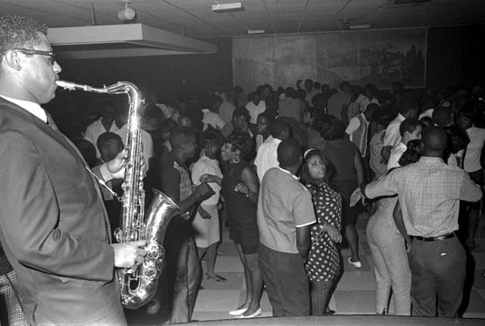 People dance during a performance by Bobby Moore and the Rhythm Aces at the Elks Lodge in Montgomery.