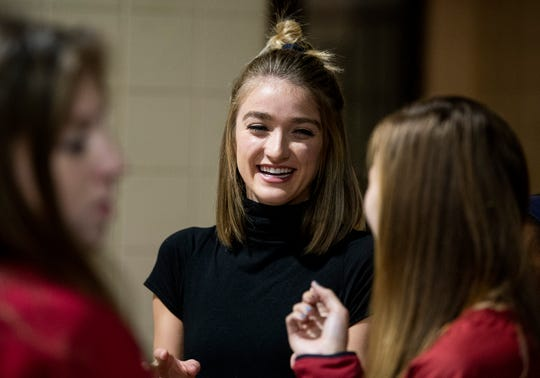 Montgomery Catholic runner Amaris Tyynismaa laughs with classmates as she announces that she has signed with Alabama during the early signing day ceremony at the Catholic campus in Montgomery, Ala., on Wednesday December 18, 2018.