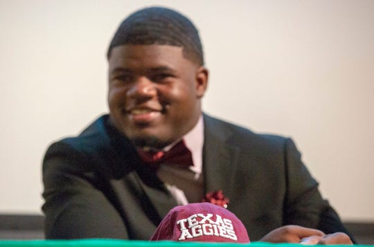 Ke'Shun Brown, a Carver High senior, signed with Texas A&M on early signing day.