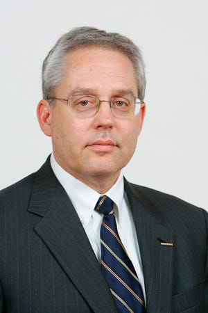 This undated photo released by Nissan Motor Co. shows Nissan executive Greg Kelly. Tokyo prosecutors on Monday, Dec. 10, 2018, charged Nissan's former chairman Carlos Ghosn with underreporting his income, with Kelly and the company, according to Japanese media reports. Kelly, 62, is suspected of having collaborated with Ghosn. Kelly's attorney in the U.S. says he is asserting his innocence. (Nissan Motor Co. via AP)