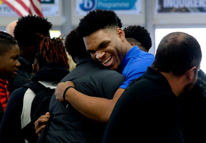 Hillsboro's Joe Honeysucker is greeted Wednesday before signing his letter of intent to play for Memphis.