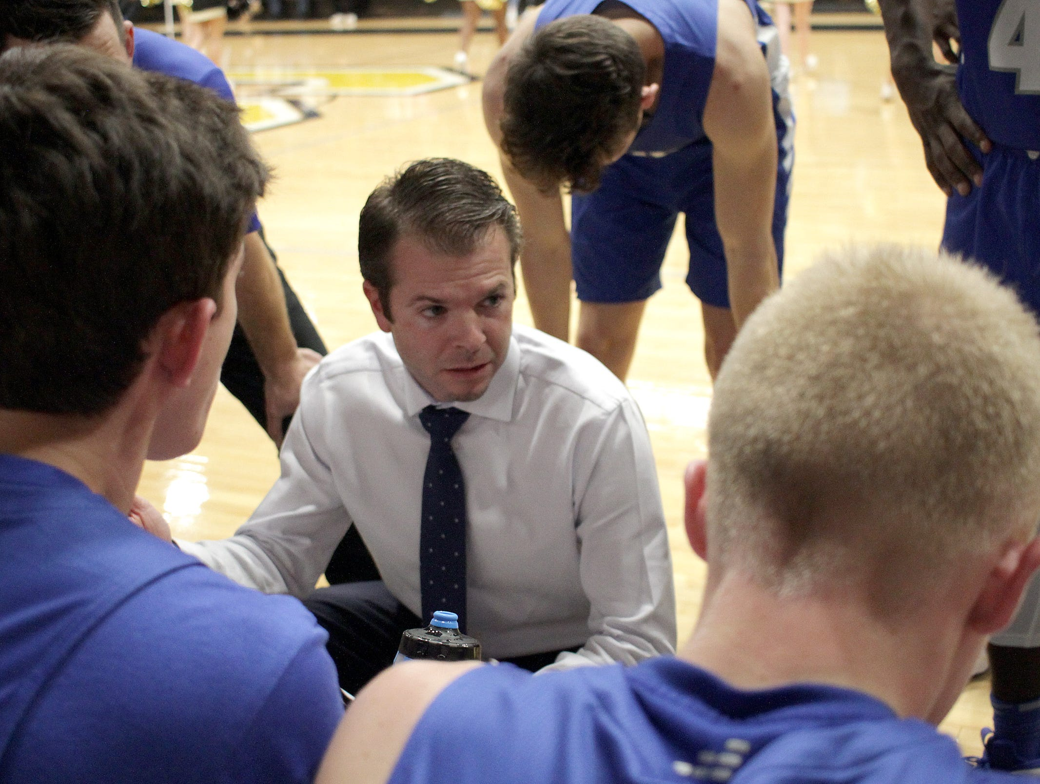 White House Coach Caleb Cook talks to his team at they play Springfield on Tuesday, December 18, 2018.