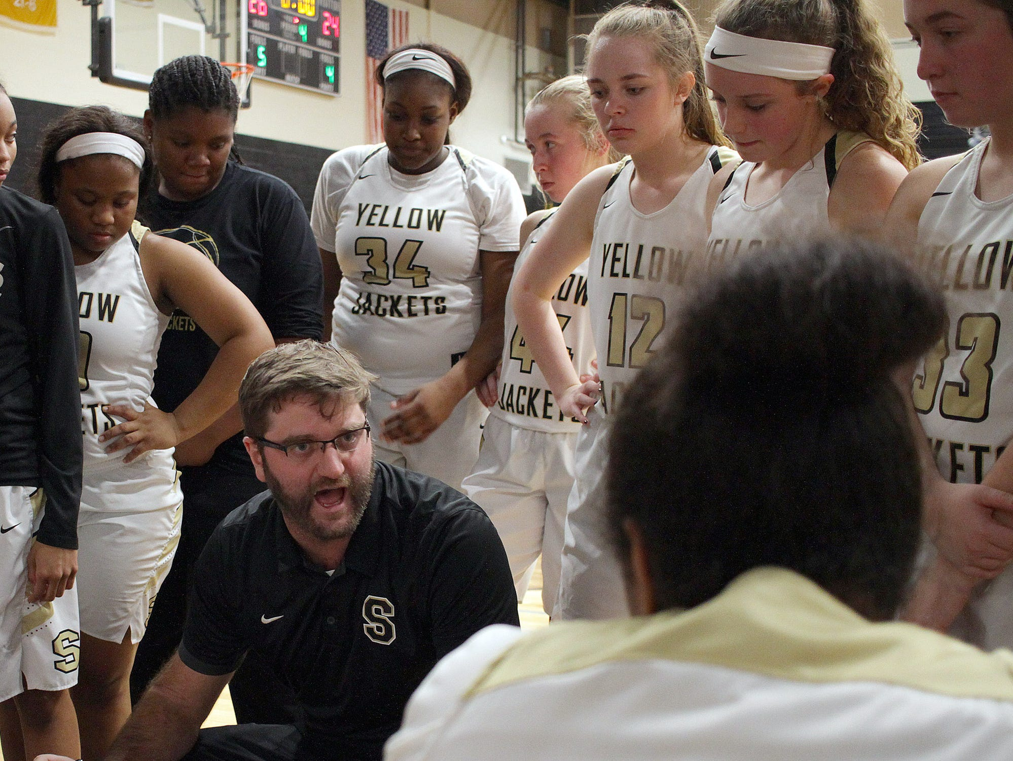 Springfield coach Todd Babbintgon talks to his team as they host Whte House on Tuesday, December 18, 2018.
