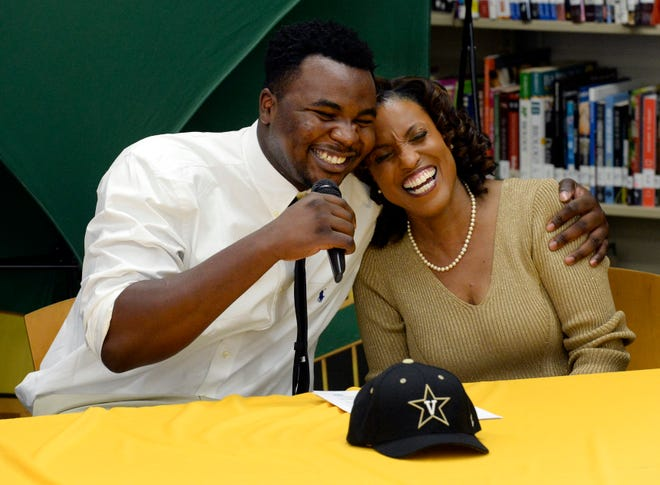 Hillsboro's Donald Fitzgerald hugs his adoptive mother, Cynthia Fitzgerald, while he thanks her before signing his national letter of intent on Wednesday. Fitzgerald, who was born in Nigeria and came to the United States to play basketball, played one season of high school football and signed with Vanderbilt.