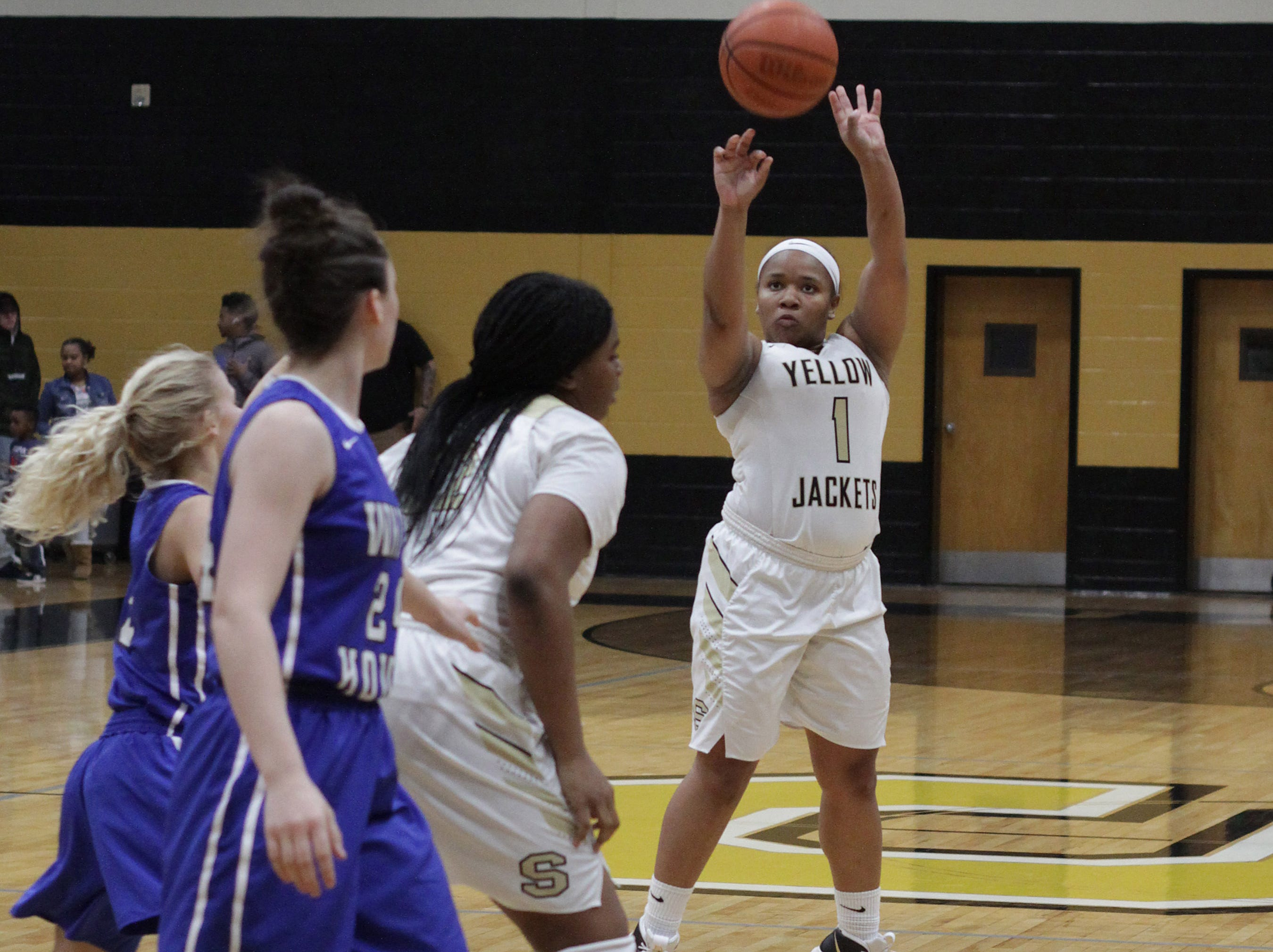 Springfield's Marina Sherrod shoots a jumper against White House on Tuesday, December 18, 2018.