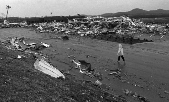 A lone figure walks through the devastation left by a tornado on Dec. 24, 1988, in Franklin.