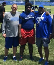 Jimmy Nixon, center, attended football camp at Tennessee State last summer. He is pictured here with TSU offensive line coach Russ Ehrenfeld, left, and coach Rod Reed, right.