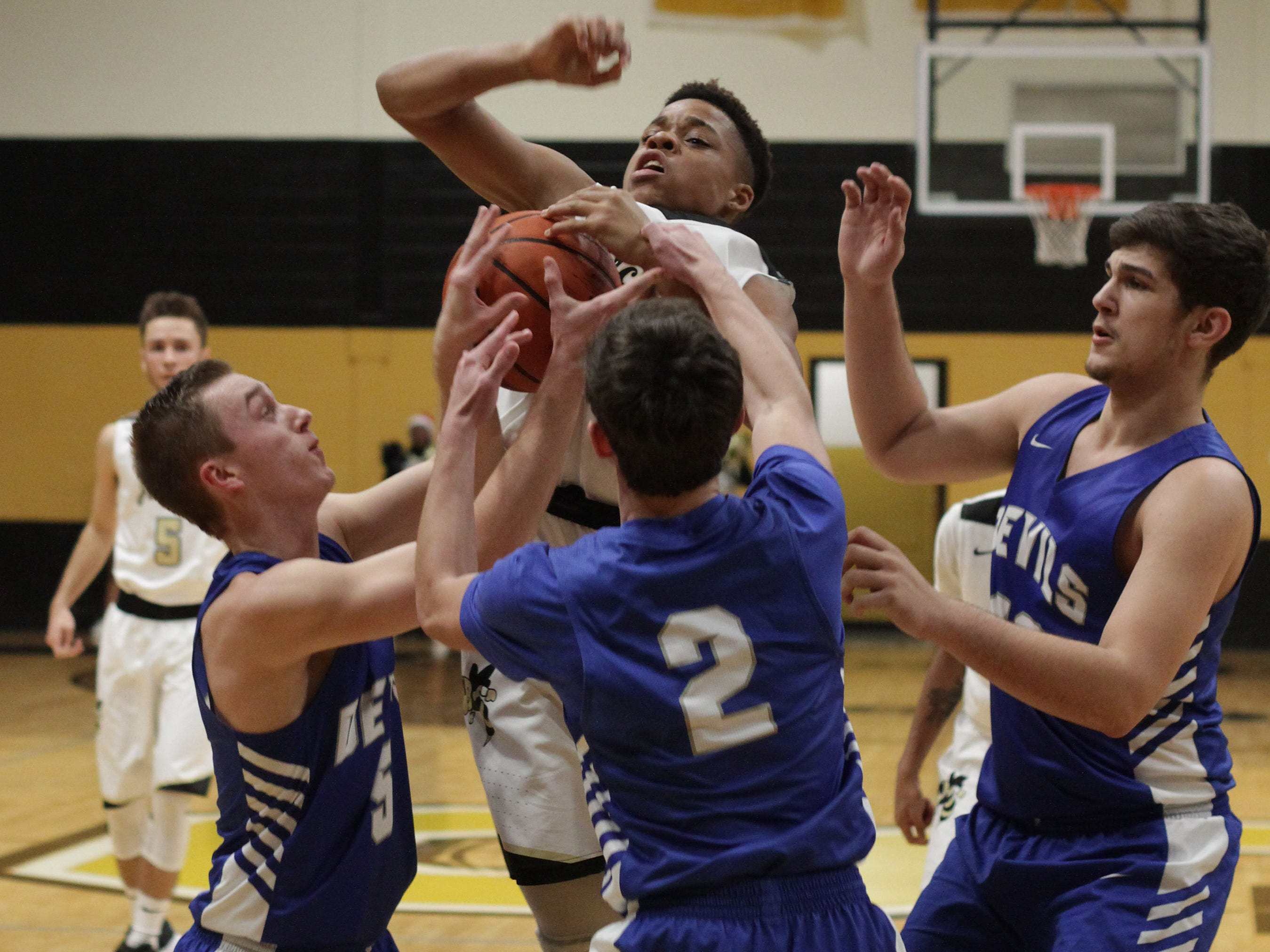 Springfield's Keyshawn Robinson is triple teamed by White House on Tuesday, December 18, 2018.