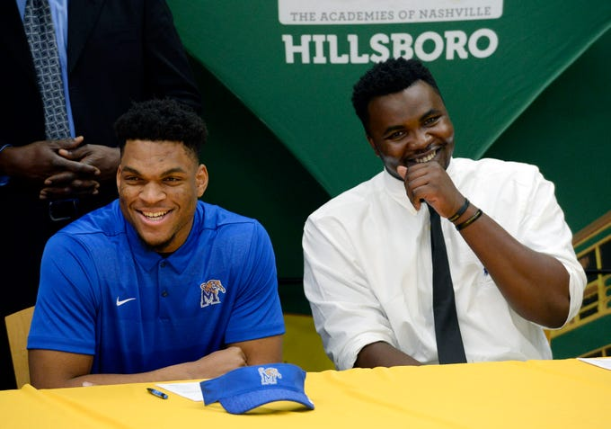 Hillsboro High School's Joe Honeysucker, left,  and Donald Fitzgerald wait to sign their national letters of intent to play football in college on Wednesday, Dec. 19, 2018, in Nashville,Tenn. Honeysucker is signing to play for Memphis. Fitzgerald, who played one season of high school football, is the adopted son of Hillsboro Coach Maurice Fitzgerald and is from Nigeria. He is playing for Vanderbilt.
