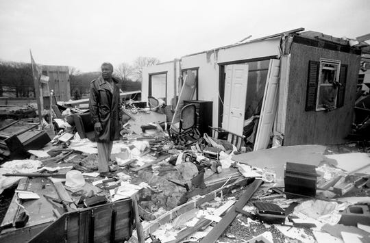 Hardy Britton surveys the rubble of his home on Mallory Station Road after the tornado stuck the morning of Dec. 24, 1988. His wife, Mary, suffered minor injuries after being blown through the bedroom window.