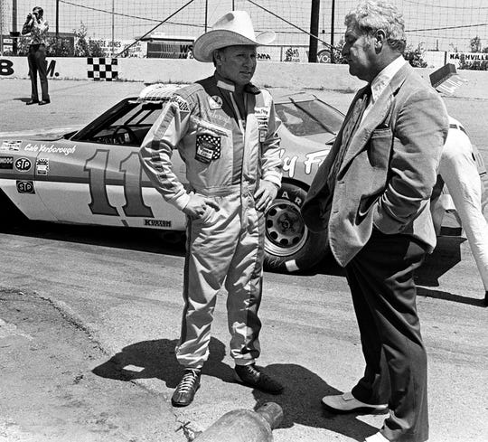 Cale Yarborough, left, gets interview by The Tennessean Sports Editor John Bibb during practice for NASCAR Music City 420 race at the Nashville Speedway. Dale Ernsberger / The Tennessean 5/8/1976