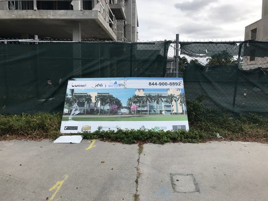 A sign at the construction site, on Nov. 27, 2018, offers a glimpse of the stalled Bay Club of Naples project.