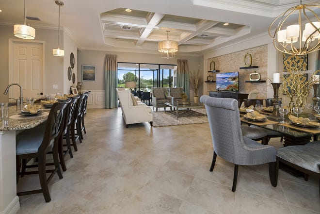 Maria model has 2,247 square feet under air, three-bedroom plus den, a great room, island kitchen, and dining area.
