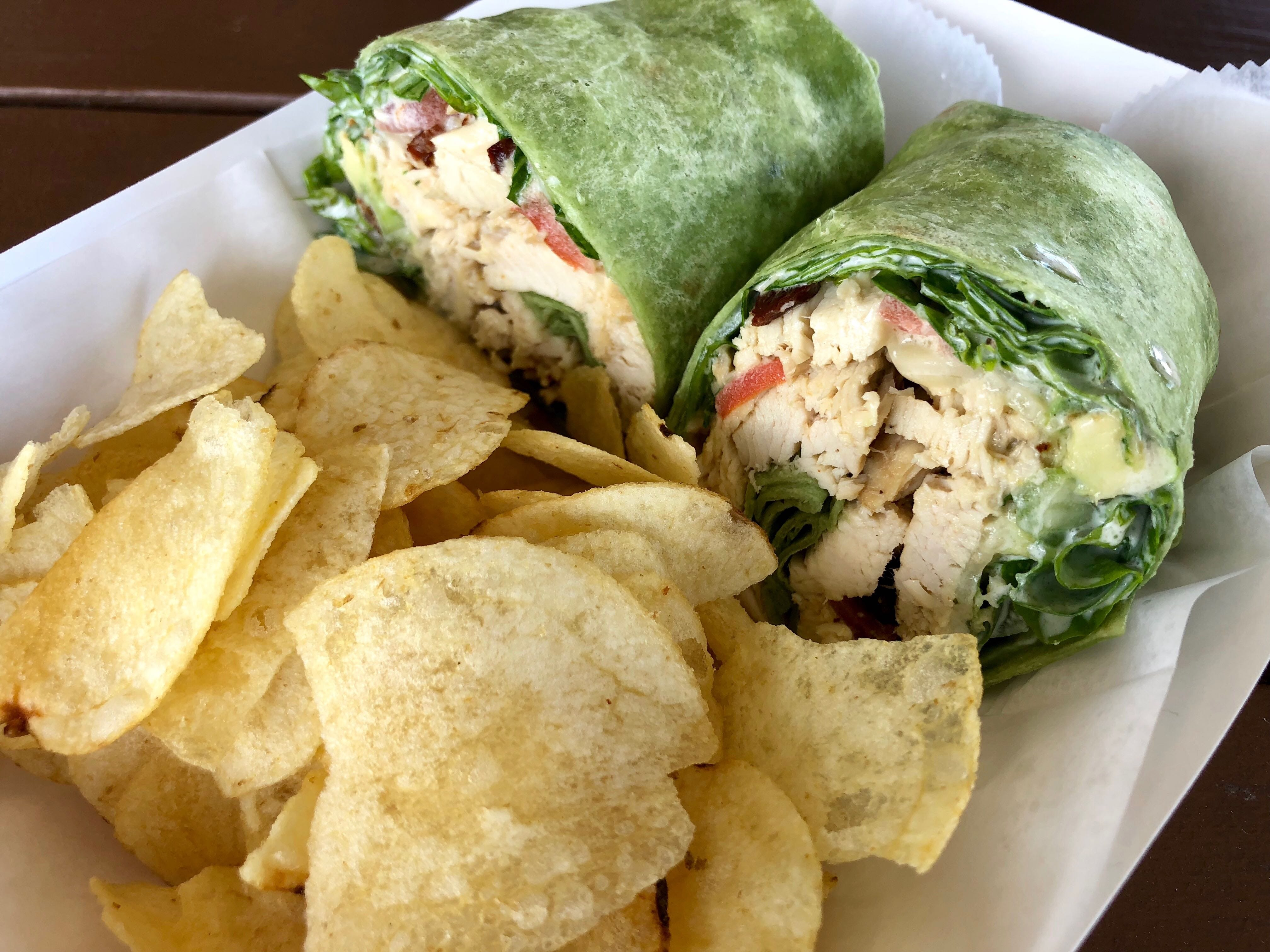 A farm wrap made with apple chicken, avocado, greens and a cucumber ranch dressing at Fresh Harvest Cafe.
