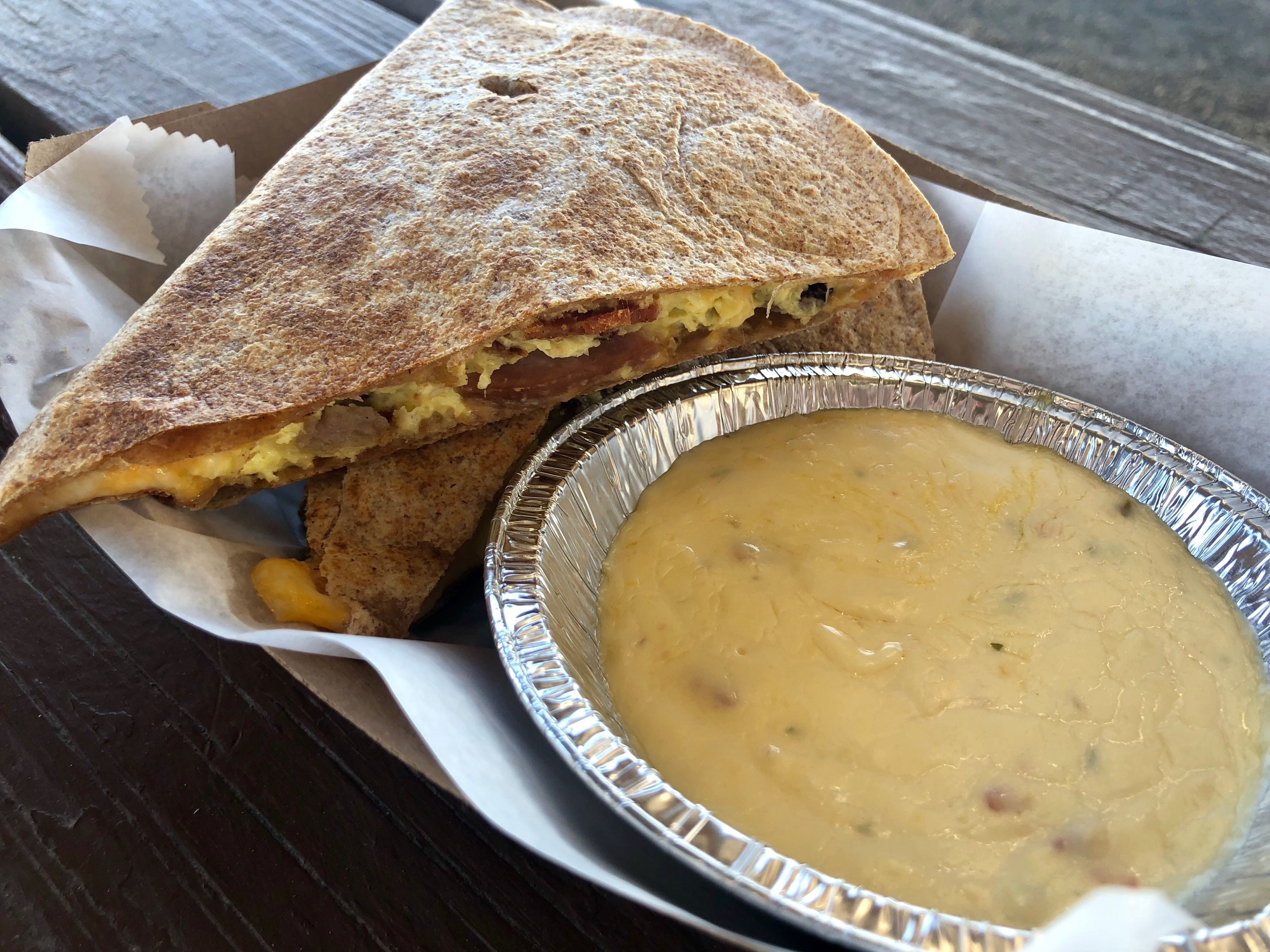 A  meat lovers breakfast quesadilla filled with bacon, sausage and ham at Fresh Harvest Cafe in Bonita Springs.