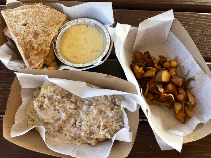 Breakfast at Fresh Harvest Cafe, including a meat lovers breakfast quesadilla,  home fries and biscuits and gravy.