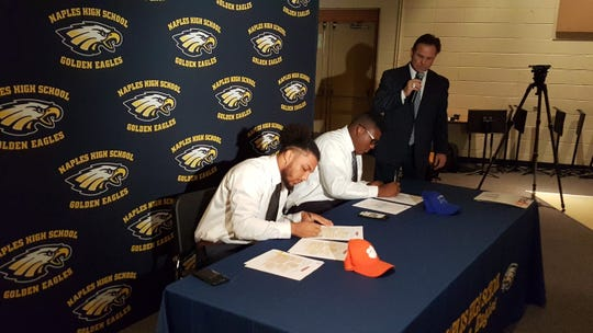 Naples High School running back Chez Mellusi, left, and Dorian Hinton sign Division I letters of intent Wednesday. Mellusi committed to Clemson, while Hinton is headed to Middle Tennessee State.