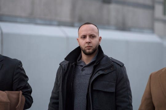 Matthew Torres leaves Federal Court in Newark on Wednesday, December 19, 2018. Matthew Torres was arrested Wednesday morning by federal agents, and charged with participating in an illegal traffic stop in Paterson last December with Eudy Ramos, another accused officer, according to authorities.