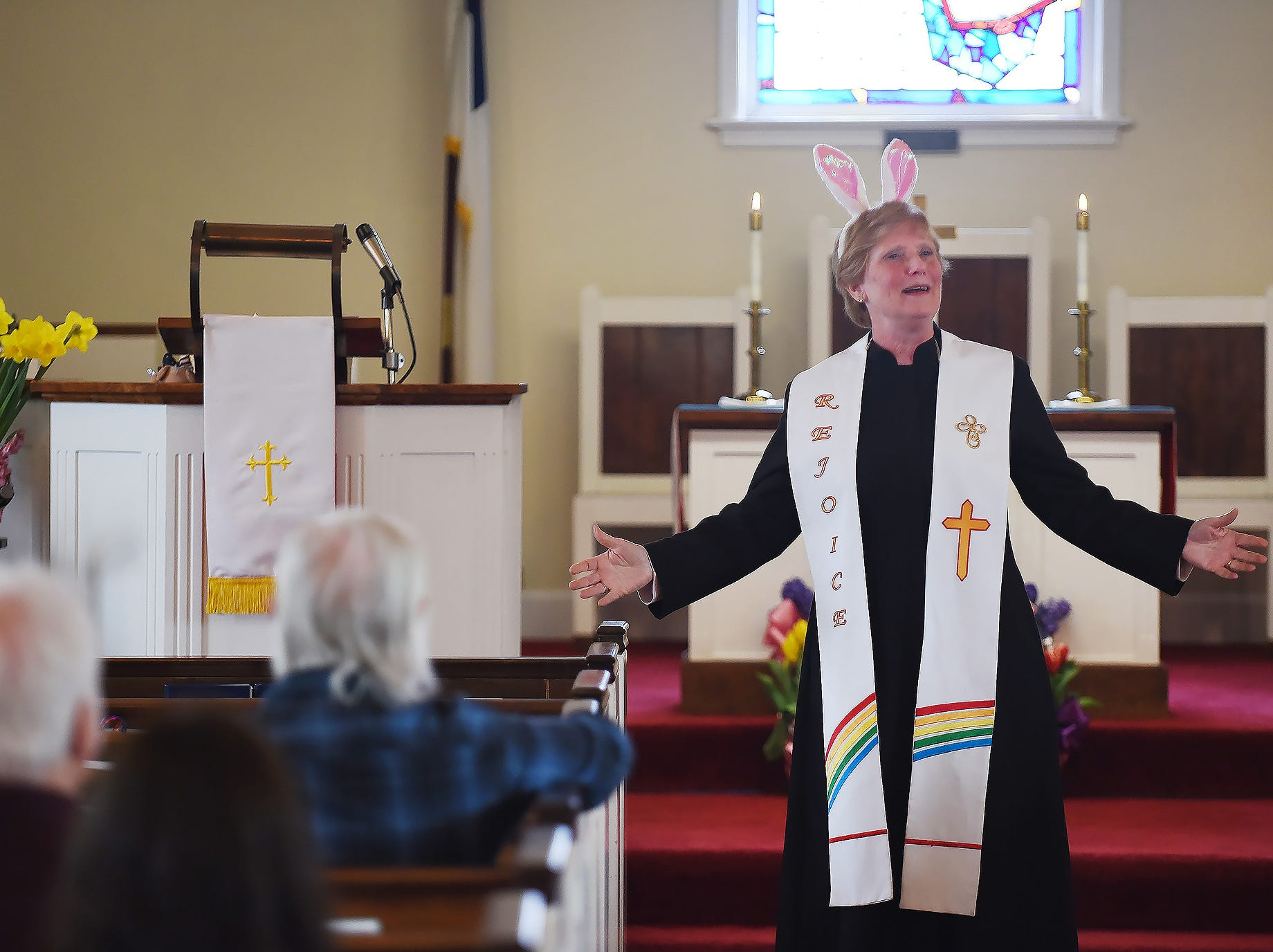 Lay Pastor Linda Van Kampen leads the congregation as she wears bunny ears while showing her various choices for participating in the Easter parade, photographed during the Easter service at United Presbyterian Church in Lyndhurst on 04/01/18.
